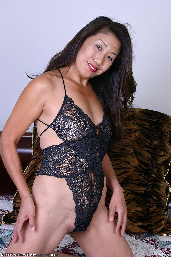 Exotic  Cougar in Ebony Thong Peels and  Opens Her Asian  Hoo Ha