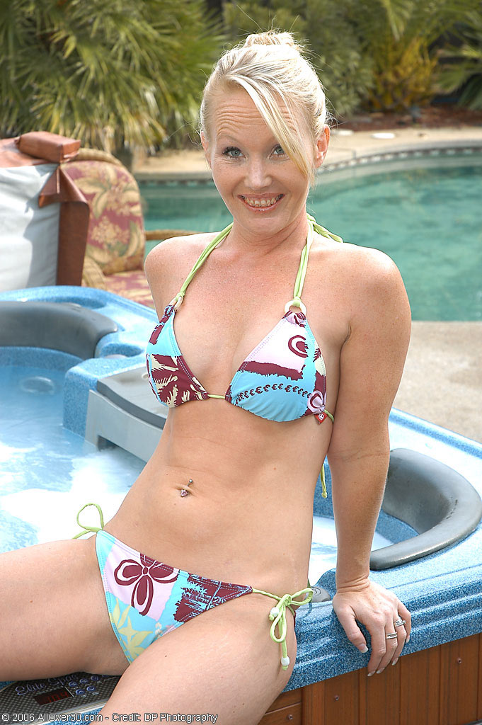 Blond Haired  Cougar Does a Little Skinny Dipping in Her Back Yard