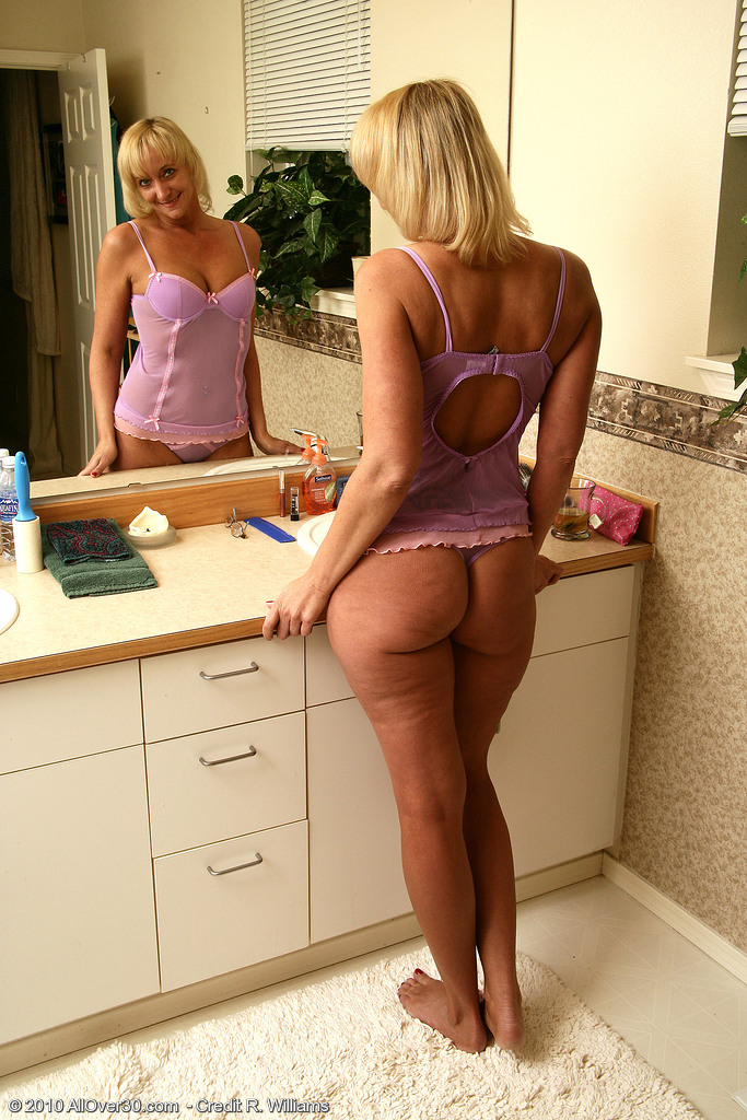 44 Year Old  Blond Barbie Slides a Few Finger into Her Shaved  Older Slot