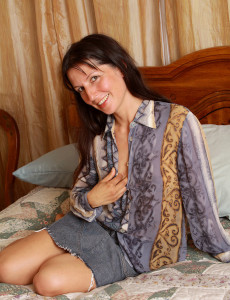 Toying 41 Year Old Carmen T Glides a Blue Vibrator Deep Inside Her