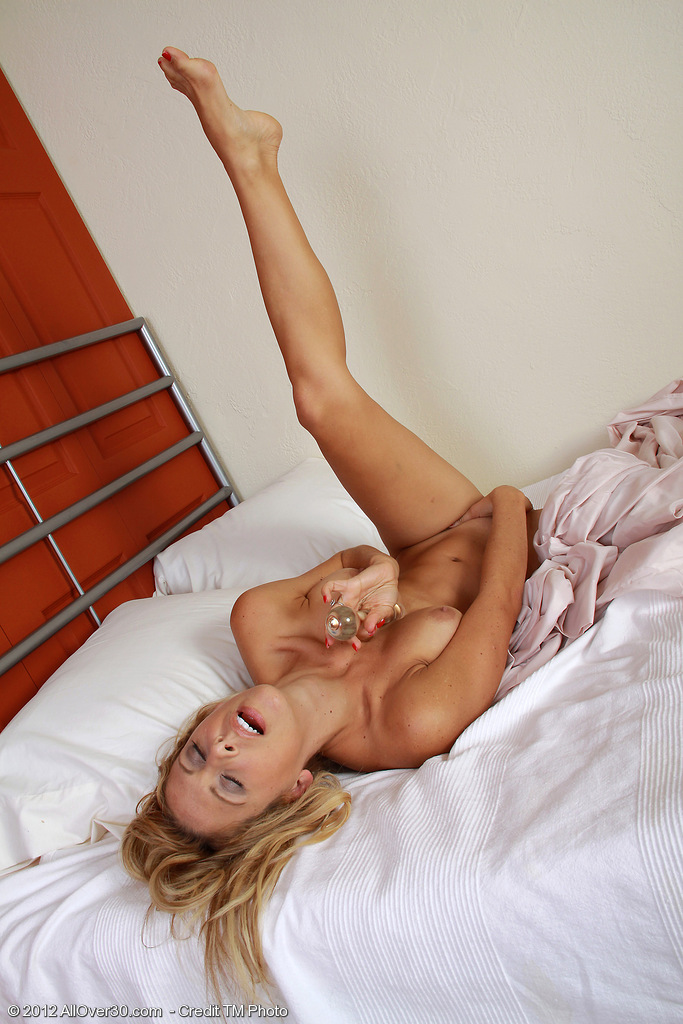 32 Year Old Milf Cherie Deville Slips a Glass  Dildo Deep Inwards of Her