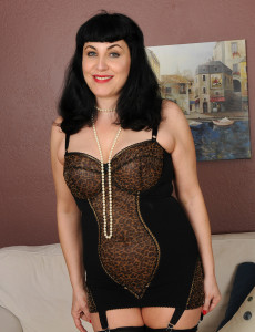 New  Older Babe Model Claudine Dips a Strand of Pearls into Her  Older Babe Box