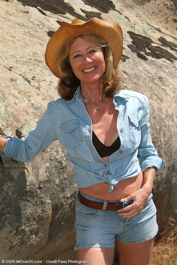 61 Year Old Janet L Peels of Her Blue Denim and  Opens on the Rocks
