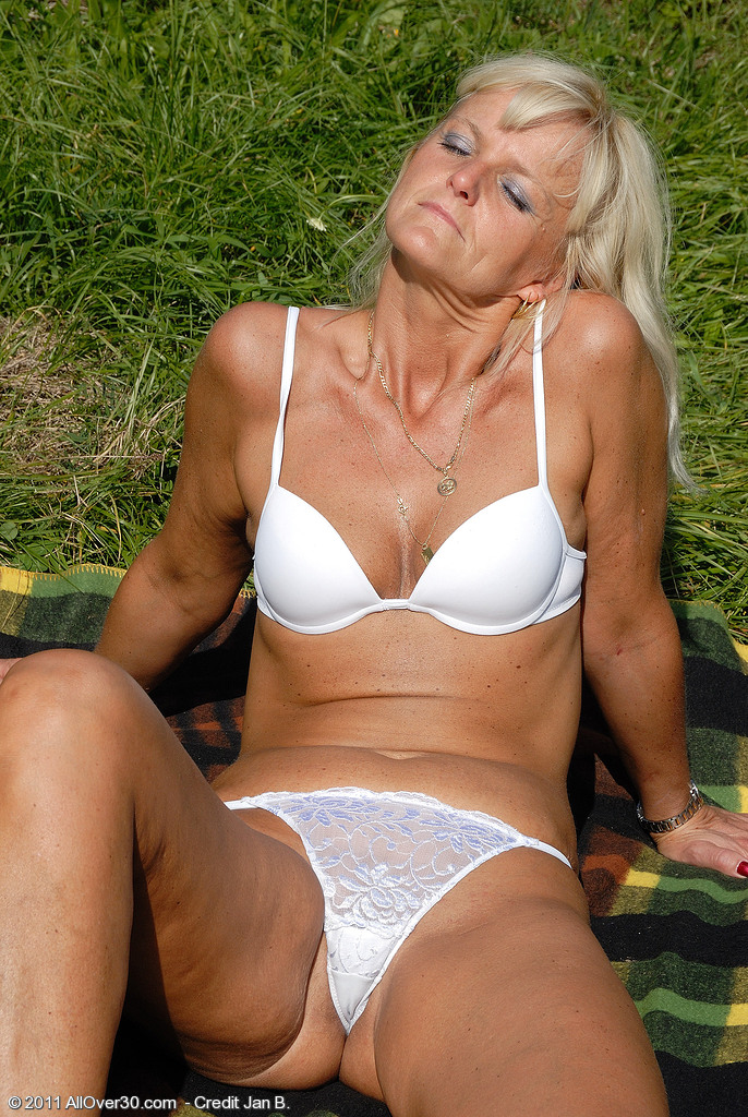 43 Year Old Jenny F  Unwraps and Shows off Her Tight   Ass in the Grass