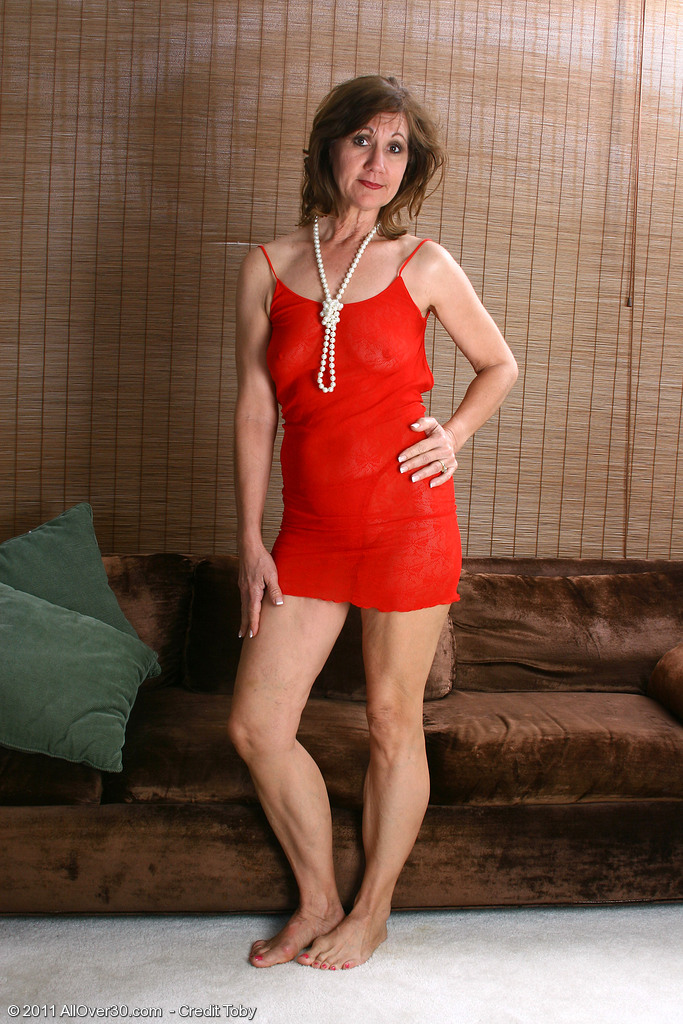 51 Year Old  Wife Lynn Shows off Her Body Frames in Pearls Here