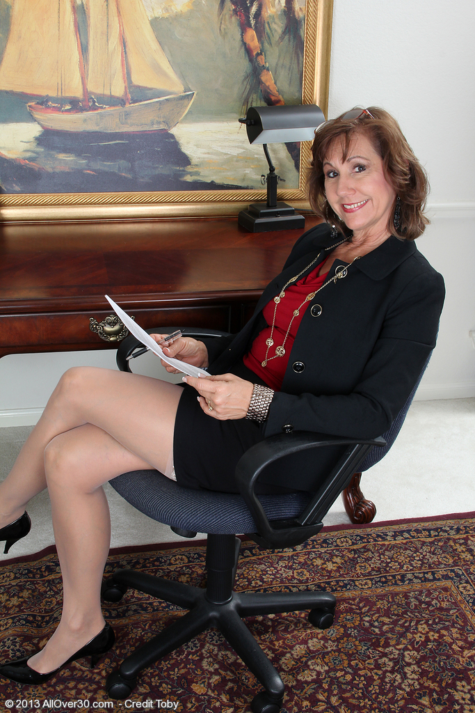 53 Year Old Lynn Takes a Break from Her Steno Work to Show off Her Assets