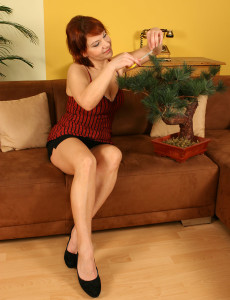 Crimson Headed  Wife Shows off Her Wares from Her Couch