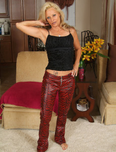 Hot  Blond 47 Year Old  Undresses off Her Red Latex for These Pics