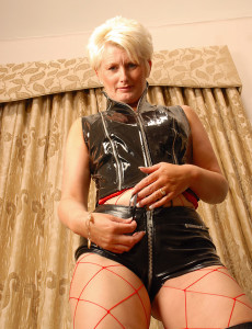 Fetish  Cougar in Leather Shows off Her  Older Honey Figure for the Camera