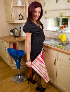 Alluring Redheaded Cougar Sofia Busy in the Kitchen with