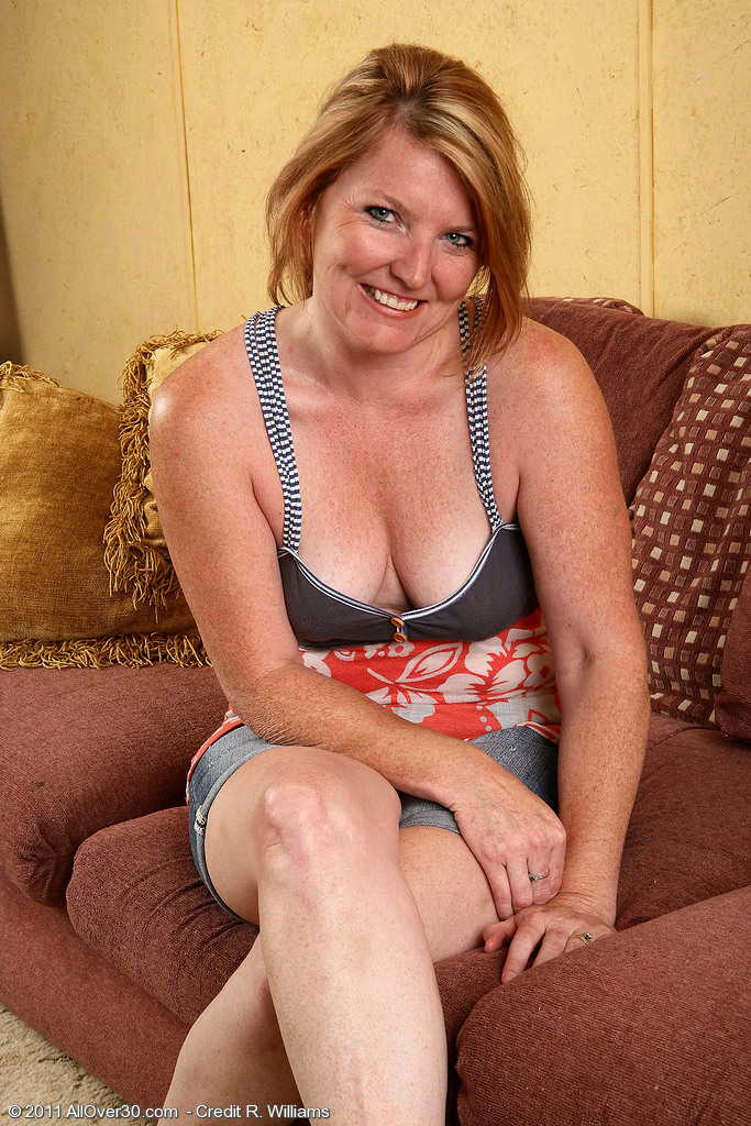 Sexy 42 Year Old  Blond Haired Stacie Downright Love Her Wand on the Couch