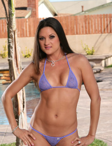 Stephanie Swift  Takes off off Her Swimsuit and Spread Her Long Gams Outdoors