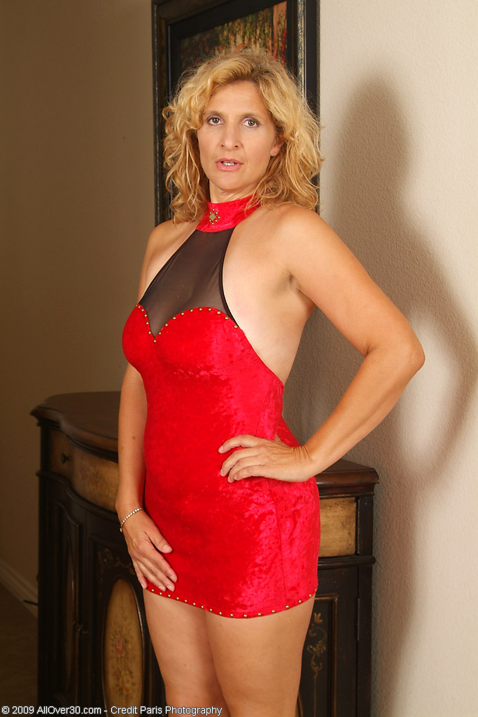 45 Year Old Tara from  Milfs30 Poses in and out of Her Red Dress