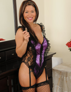Exotic  Cougar Trisha Spread Her  Older Velvety Gams Clad in Ebony Fishnets