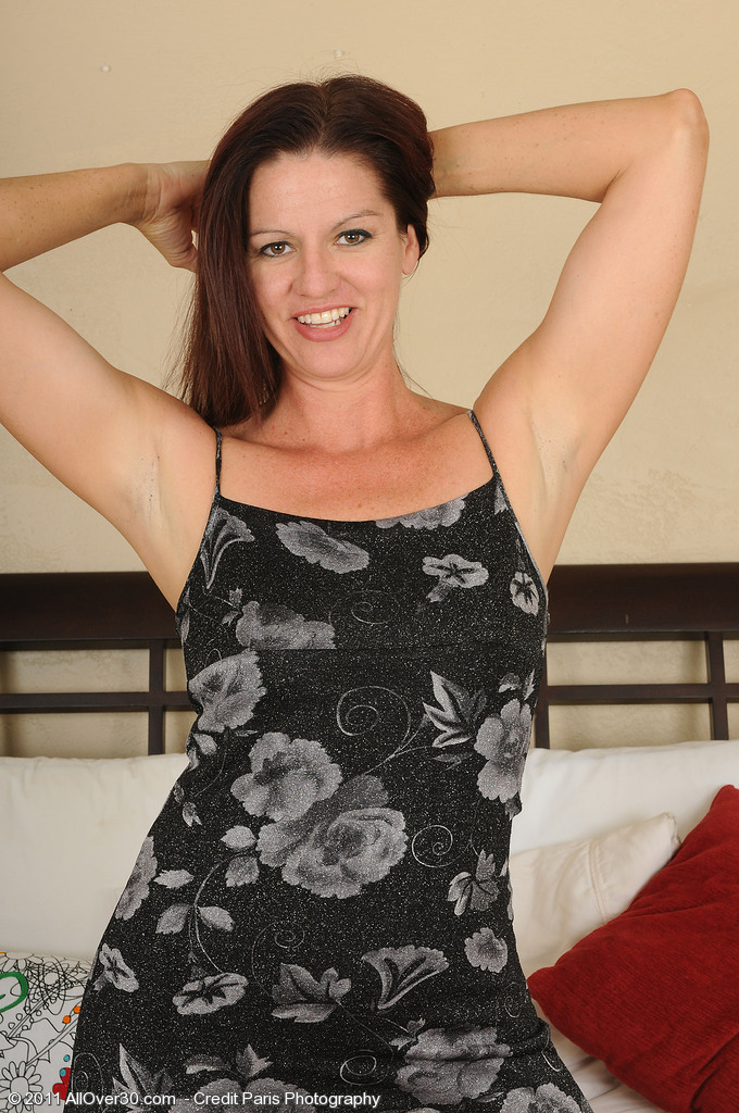 Playful 39 Year Old Xena Gets  Nude and Plays Around on Her Bed