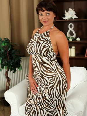 Curvaceous 38 Year Old Belle P Glides out of Her Elegant Dress to Open Up