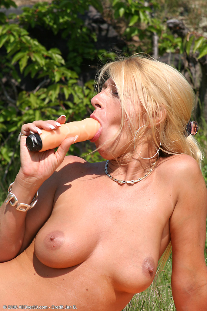 Older Babe Sylvie Outside Playing with Her Lifelike Rubber  Fake Penis