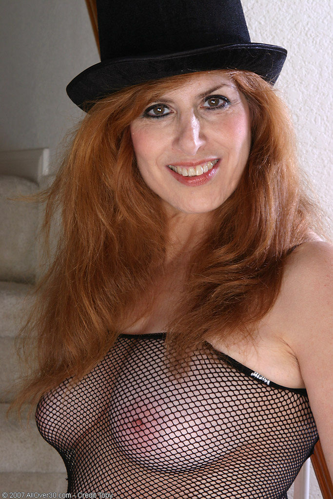Redheaded Grandma in a Fishnet Body Stocking Plays with Her Soles