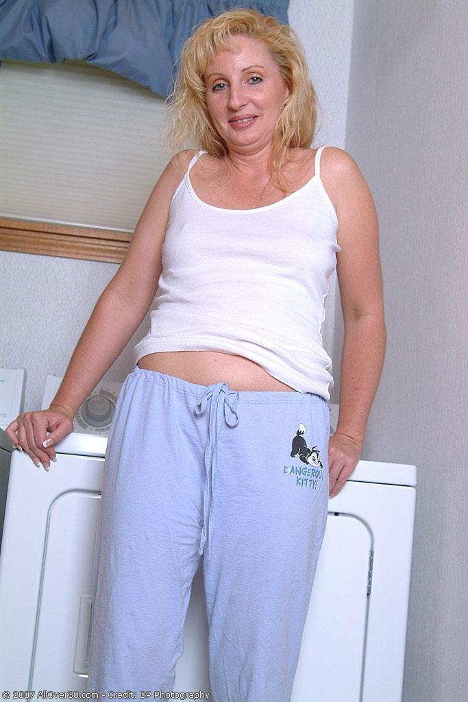 Michelle  Opens Her Long Gams on Top of the Washing Machine