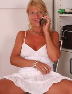 Blond and Tanned Sylvie Eases on Top of Her Plastic  Dildo