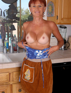 Redheaded  Cougar Kate  Opens Her Tight Asscheeks in the Kitchen