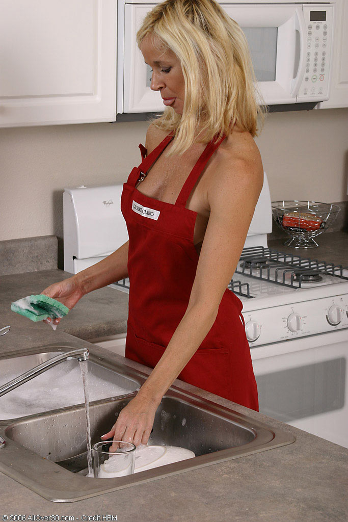 Tall  Blond  Mom Doing More Than Just Cooking in the Kitchen