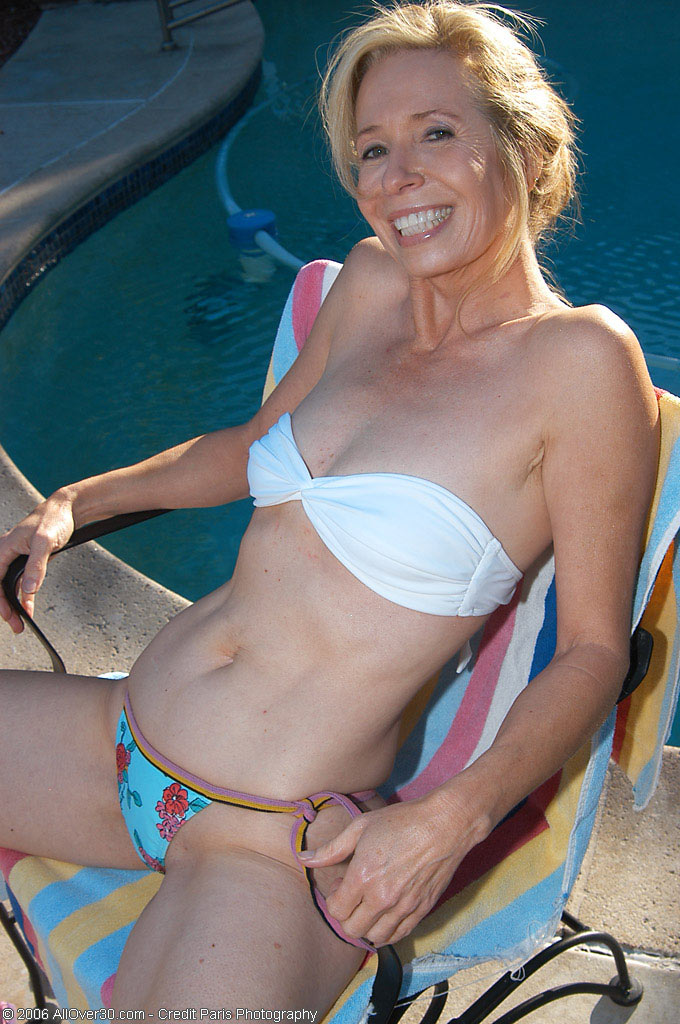 Smoking Hot 54 Year Old in the Garden for a Tan