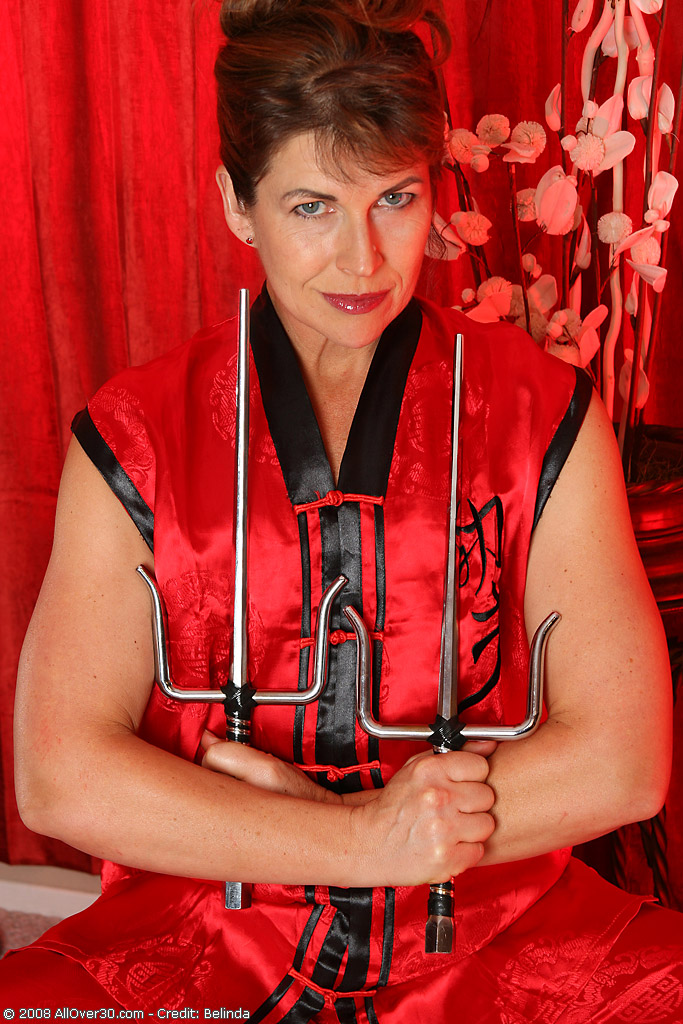 42 Year Old Andie Looks Damn Hot Playing with These Swords