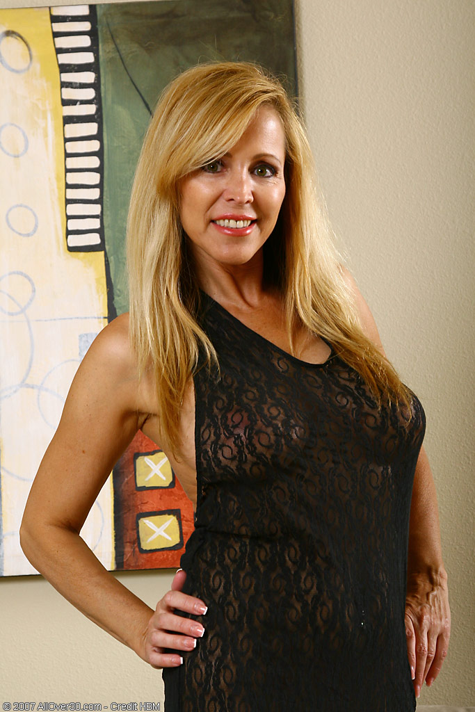 Blond and  Enormous Breasted Nicole  Undresses out of Her Long Dress and Poses
