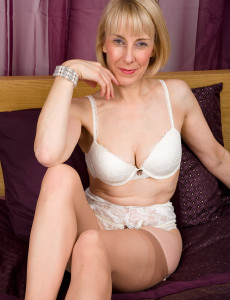 63 Year Old Hazel Pulls Her  Undies Aside to Display a Full Bush