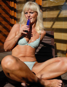 43 Year Old  Blond Haired Jenny F Slides Her Long Purple Fake Penis Deep Inwards