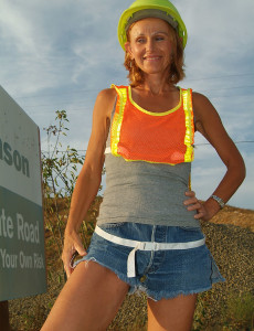 Skinny  Cougar  Opens Her Gams Outside with the Construction Tractors