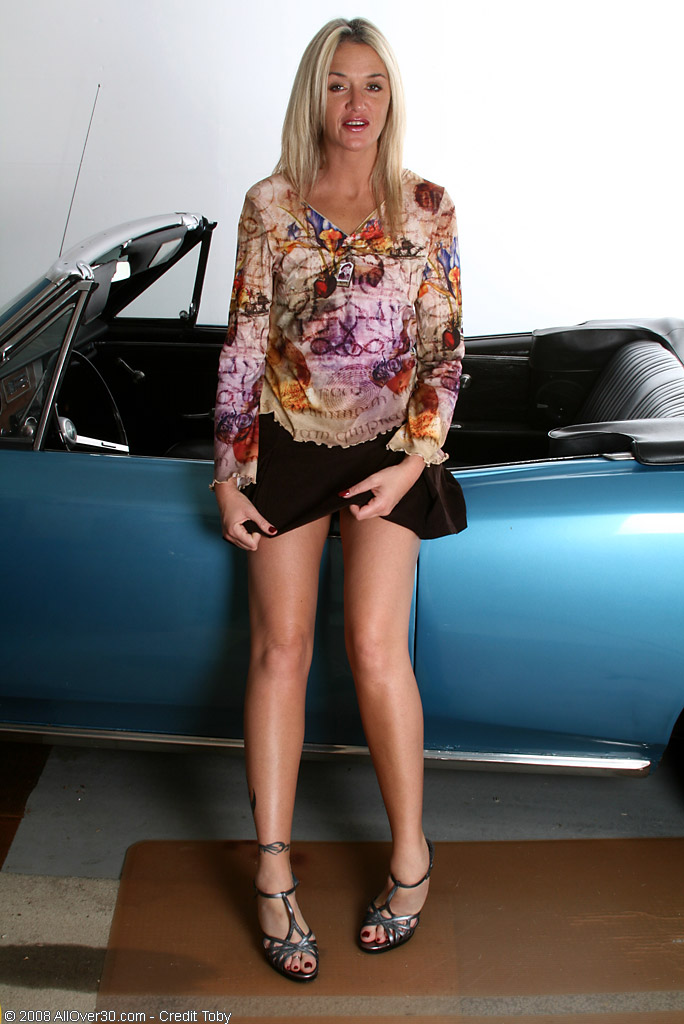 Blond Haired Layla Sparks Up a Smoke and  Opens Her Gams on Her Car