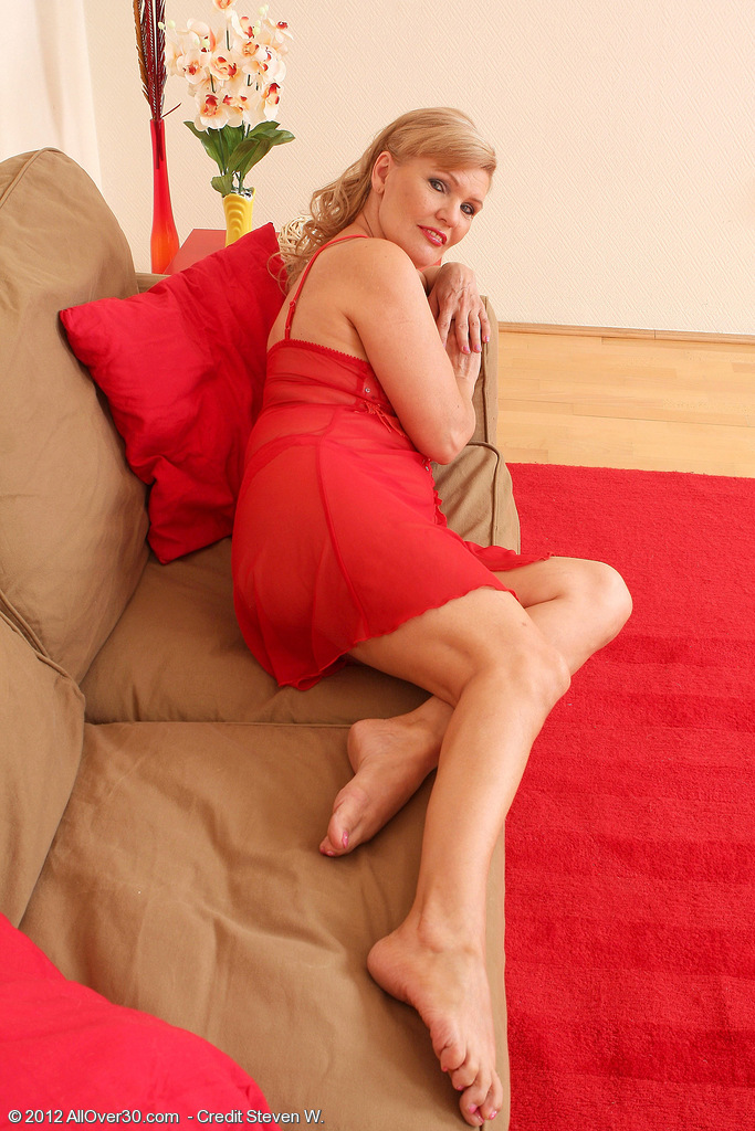 57 Year Old Lena F in  Hot Red Underwear  Opens Her Gams on the Couch