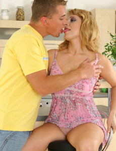 Blond Haired  Cougar Lets the Young Stud Force Himself Deep Inside of Her