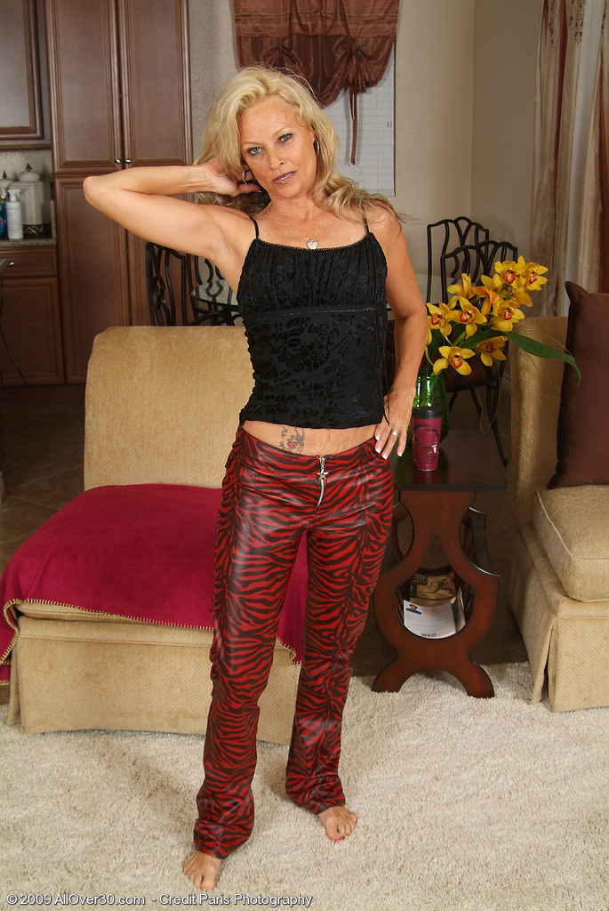 Hot Blond 47 Year Old Undresses off Her Red Latex for