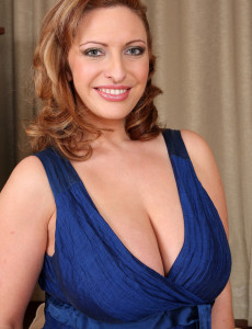 Elegant 30 Year Old Salinas Glides off Her Dress and Shows Big Tits