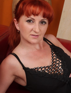 Redheaded Trixi from  Milfs30 Takes a Double Headed Dildo Deep Inside