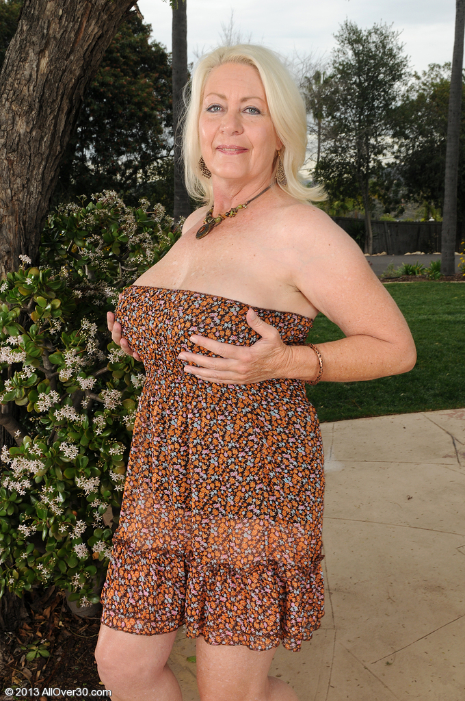 Big and Huge-boobed Angelique from  Milfs30 Opens Up Wide Outdoors