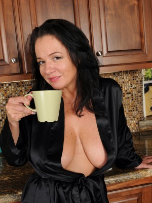 Nude milfs having coffee
