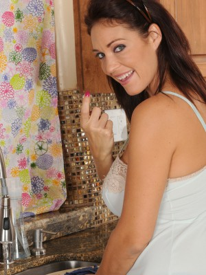 36 Year Old Charlee Chase Gets Her Big Jugs Wet in the Kitchen