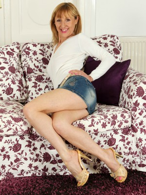 49 Year Old  Blond Haired Tina M from  Milfs30 Glides off Her Jeans Skirt