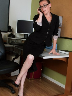 33 Year Old Amber K  Undresses and Has Along with the Woman Pussy on Her Workplace Desk