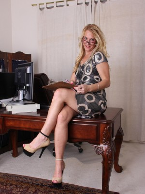 Blond Haired Secretary Jackie Keeps Late at the Office to Strip and Play
