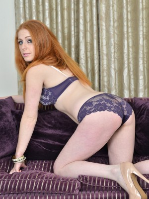 Kinky Redhead Tia Jones Disrobes Regarding Couch Demonstrating That Hairy Pussy