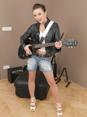 Splendid Rocker Niki Tasty Stuffs on Her Guitar and Shows off the lady Naked Body