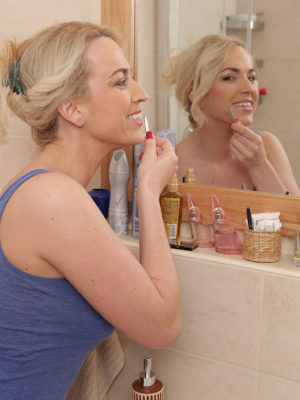 Blond Haired Eve Valentine Admires Herself into the Mirror