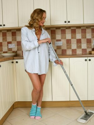 Elegant Eve mopping the kitchen